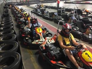 Indoor Go Kart lineup. Houston drivers ready to go on their corporate team building event!